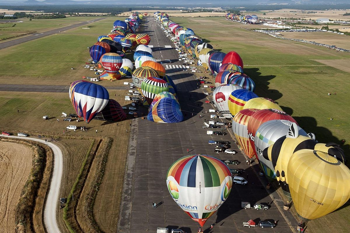 Hot air balloons waiting to take off during the international Lorraine Mondial Air Ballons festival, in Chambley-Bussieres, eastern France, on July 26, 2015.