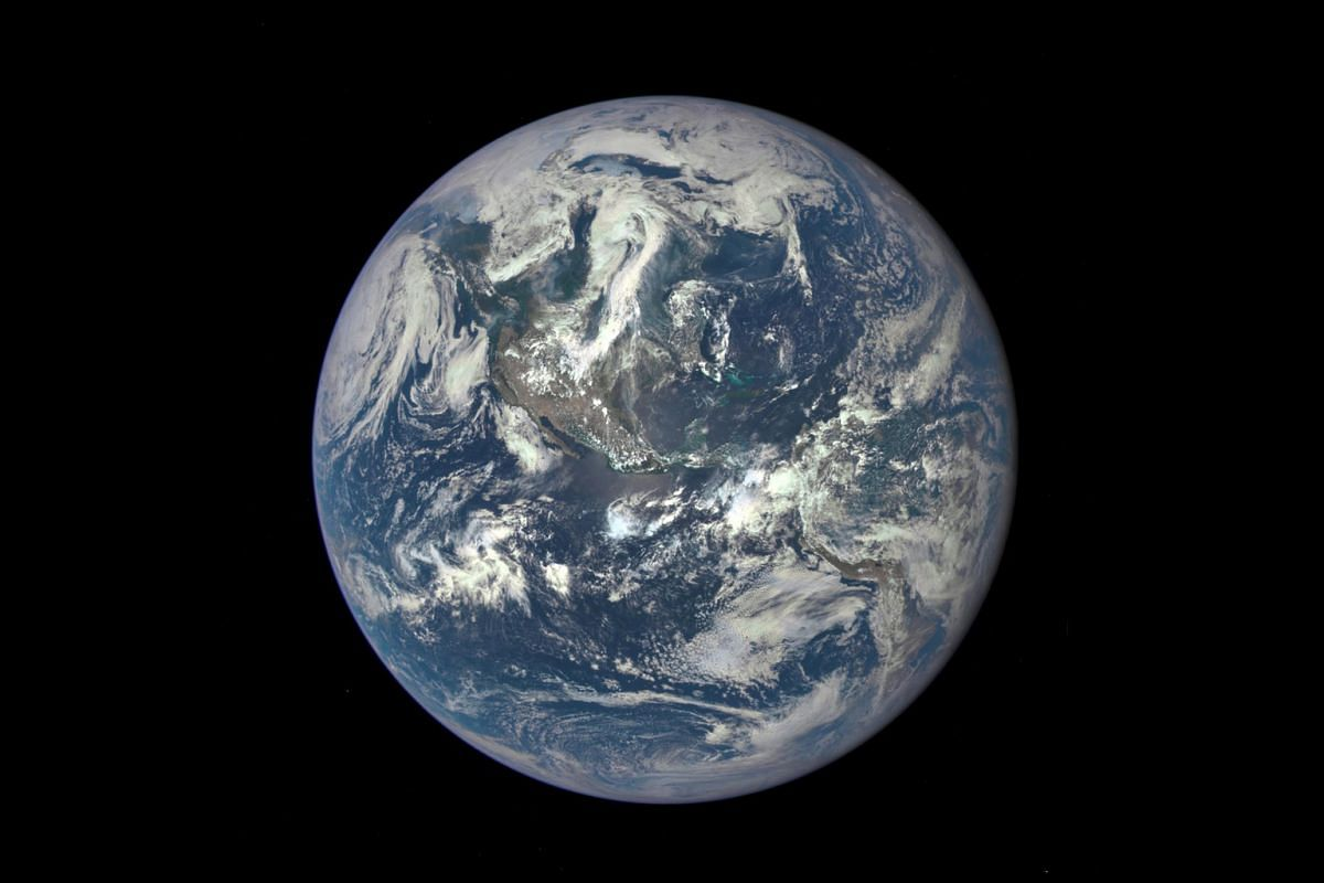 A new image of Earth, taken on July 6 with the Earth Polychromatic Imaging Camera aboard the Deep Space Climate Observatory (DSCOVR), looks a little bluer because the photo was not colour-corrected to account for sunlight scattered by air molecules.