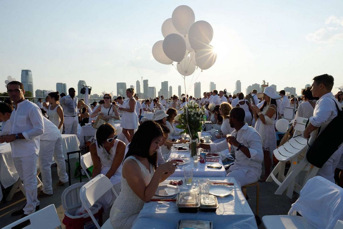Participants wait for dinner at the annual Diner en Blanc at Pier 26 in New York on July 28, 2015.