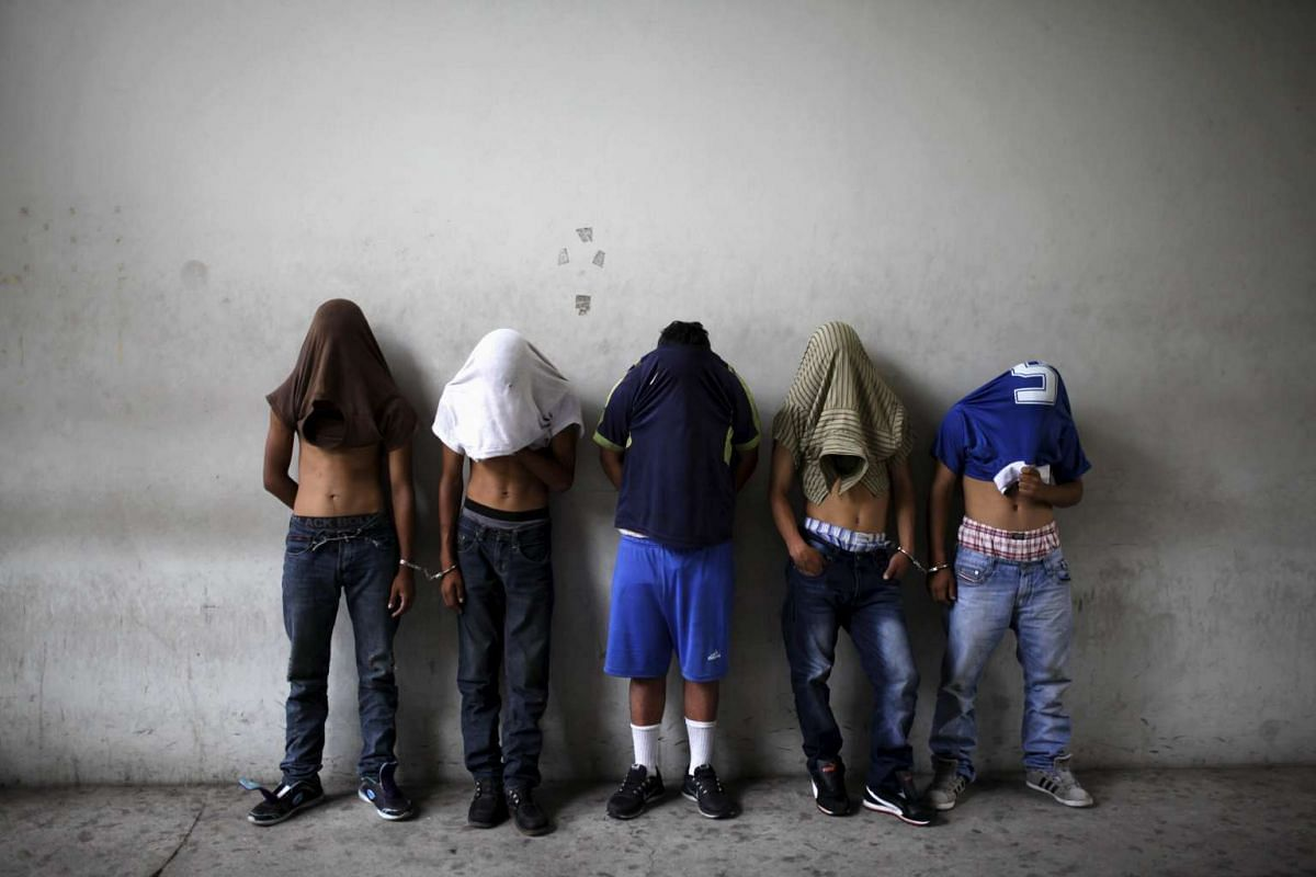 Suspected members of the 18th Street gang are presented to the media after they were arrested and accused of collaboration in the organization of attacks against bus drivers during the third day of a suspension of public transport services in San Sal