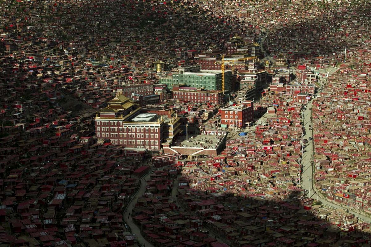 A view shows the settlements of Larung Gar Buddhist Academy in Sertar County of Garze Tibetan Autonomous Prefecture, Sichuan province, China, July 23, 2015. The academy, founded in the 1980s among the mountains of the remote prefecture, is one of the