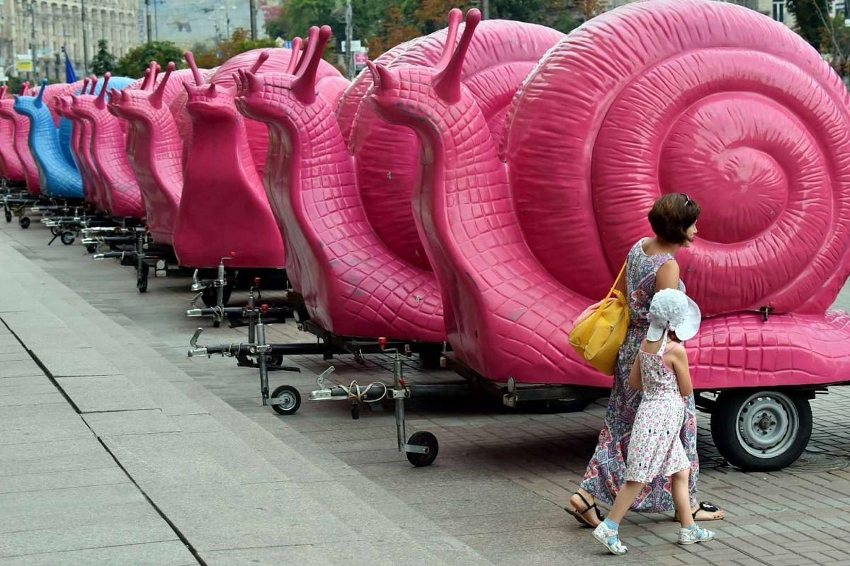 A row of coffee vendors trailers in the form of pink snails, block the entrance to the city hall and the office of the major Vitalii Klitschko during a protest in Kiev on July 30, 2015. The demonstration was staged in protest against recent legislati