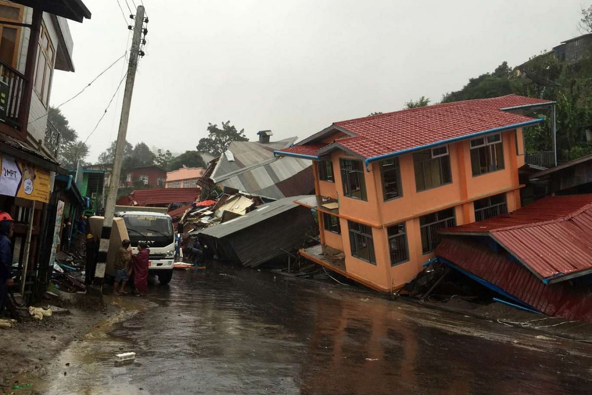 Apartments are destroyed following a landslide due to heavy rain in Harkhar, Chin State of Myanmar on July 30, 2015. Floods triggered by torrential monsoon rains have killed at least 10 people in Myanmar in the last 48 hours.