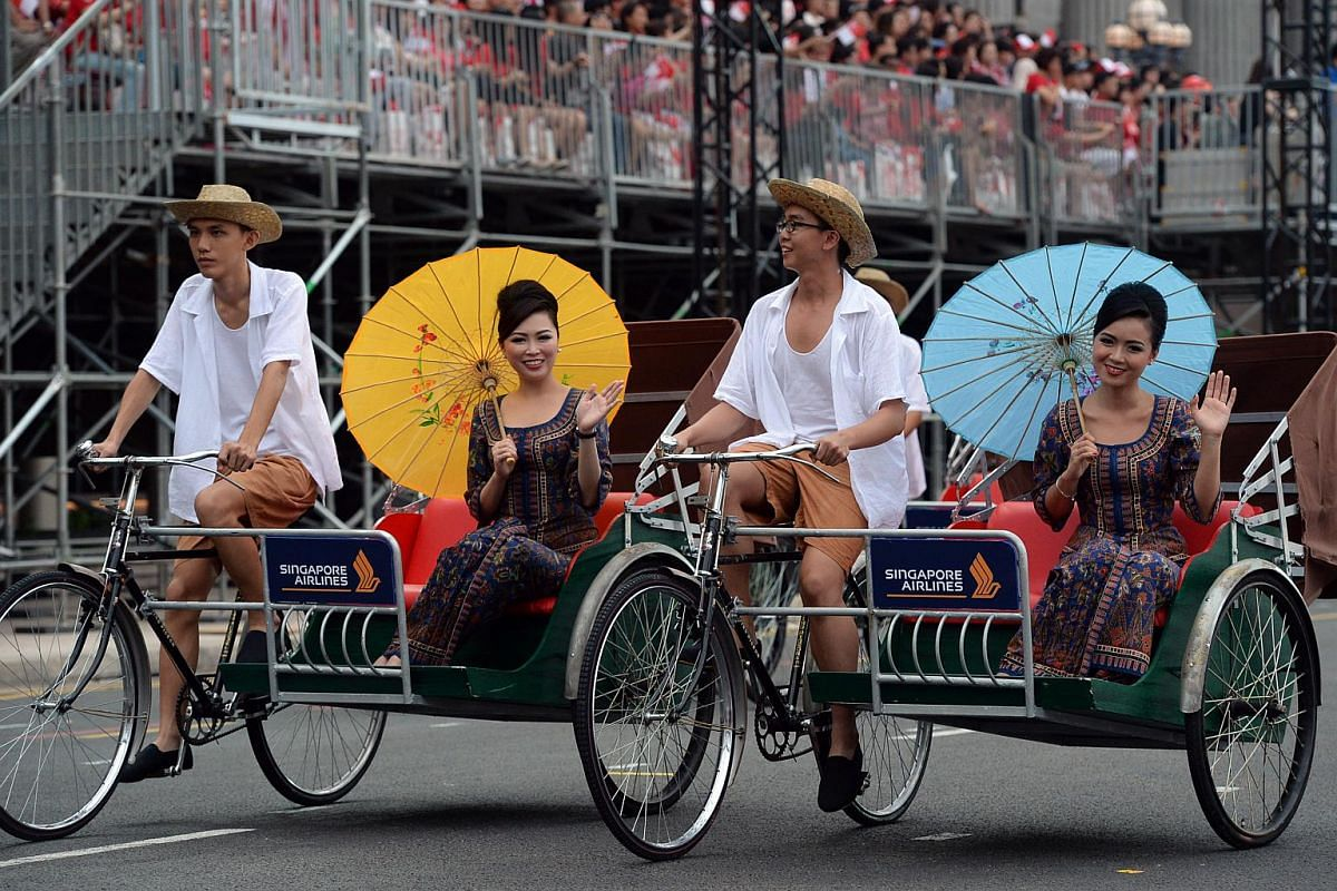 The classic icon of Singapore Airlines, the kebaya-clad Singapore Girls, ride in trishaws powered by members of the 3rd battalion guards.