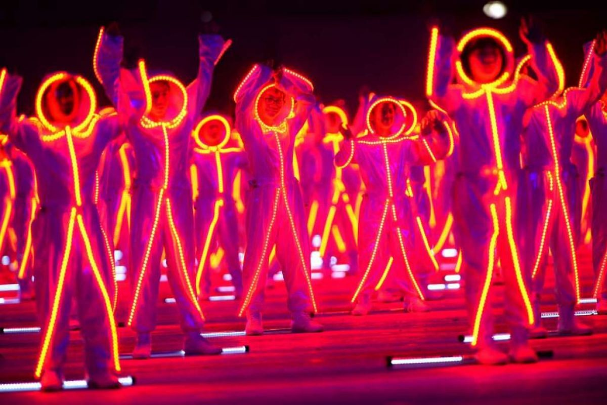 Neon stick figures come to life during one of the performance segments.