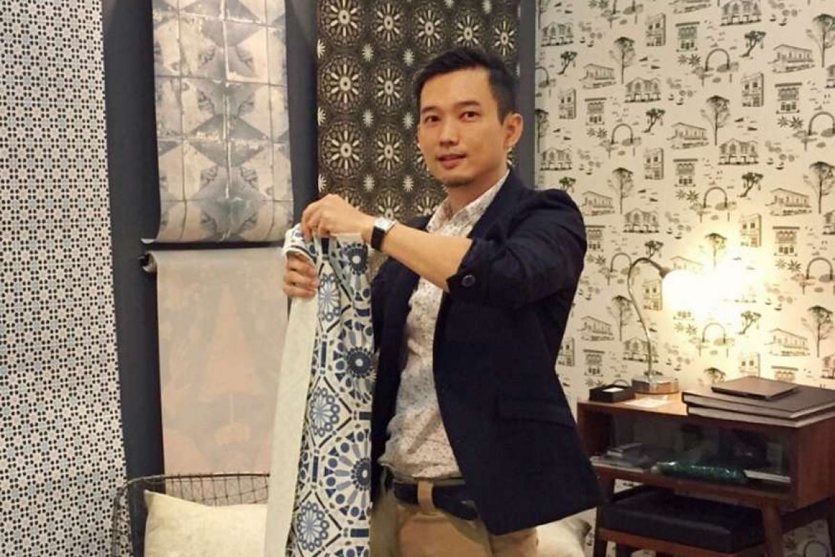 Motifs in the wallpaper and fabric designs by Mr Mike Tay (above, with the Kueh Tile fabric) are inspired by, among others, Singapore architecture.