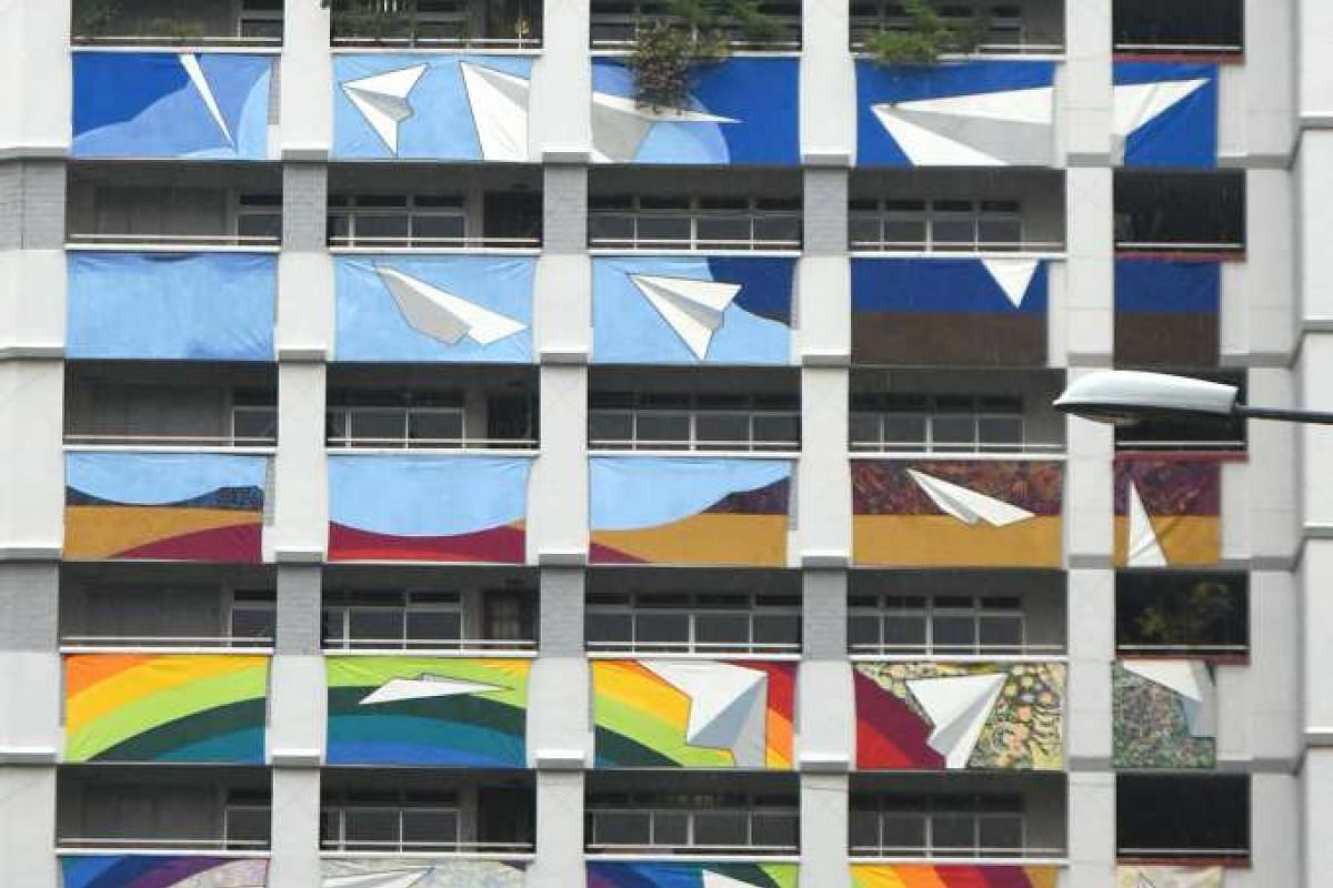Paper planes soar in Ride The Rainbow at Block 359, Yung An Road (above), while at Block 531, Jelepang Road, Bukit Panjang hills rise in Zhenghua In Harmony.