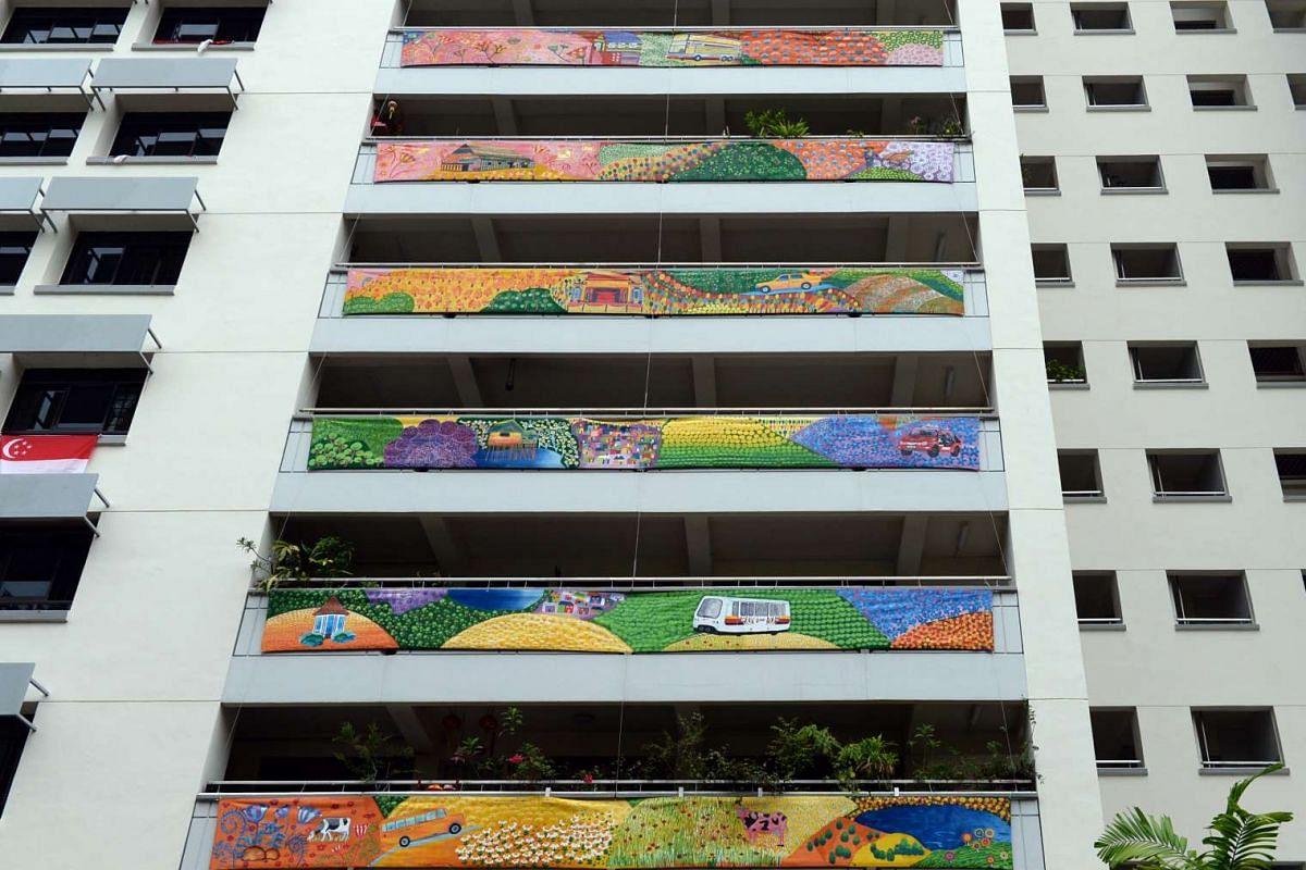 Paper planes soar in Ride The Rainbow at Block 359, Yung An Road, while at Block 531, Jelepang Road (above), Bukit Panjang hills rise in Zhenghua In Harmony.