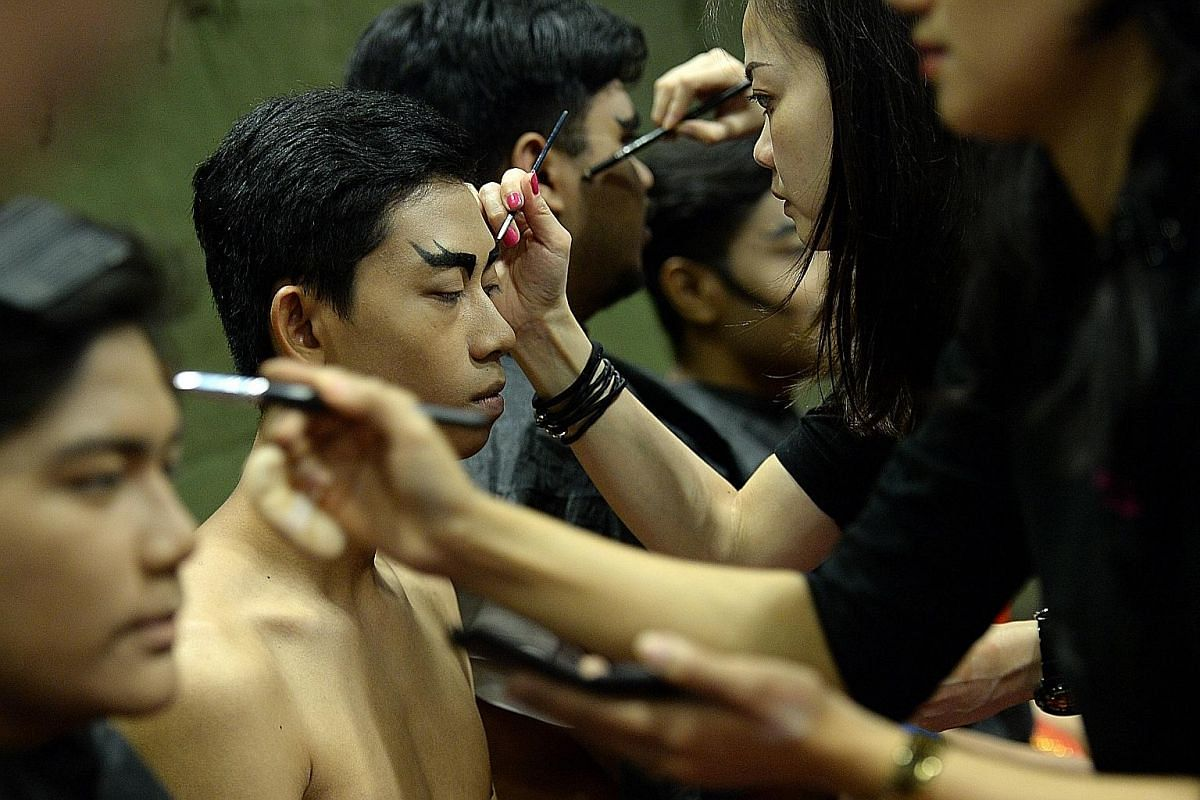 Performers getting their make-up done before a full-dress rehearsal on July 4. The performers spent over six months perfecting their routines for the show. Captain Phuah Wei Wen studied videos of PM Lee at past NDPs to prepare for his role. He hopes