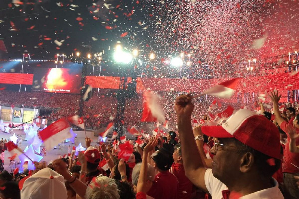 Confetti falls on the audience at the National Day Parade on Aug 9, 2015.