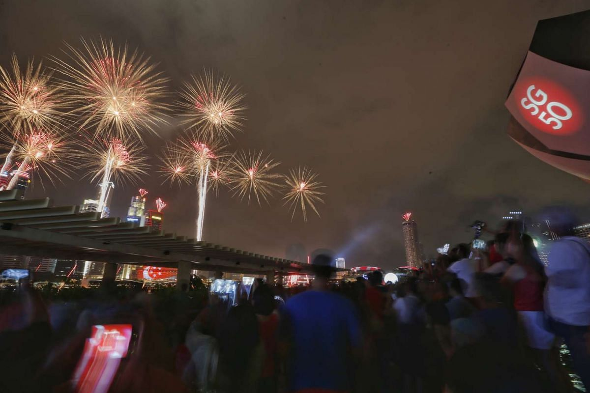 The crowd outside Marina Bay Sands watching the fireworks display.