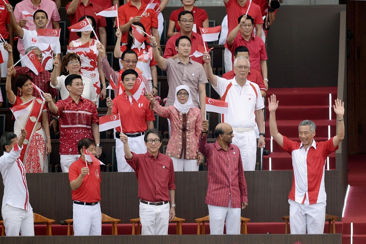 Prime Minister Lee Hsien Loong (front row, right), ministers and other MPs at the parade.