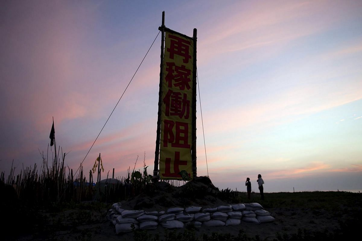"""A banner reading """"Stop Restart"""" is displayed at a protesters' campsite near Kyushu Electric Power's Sendai nuclear power station in Japan on Aug 6, 2015."""