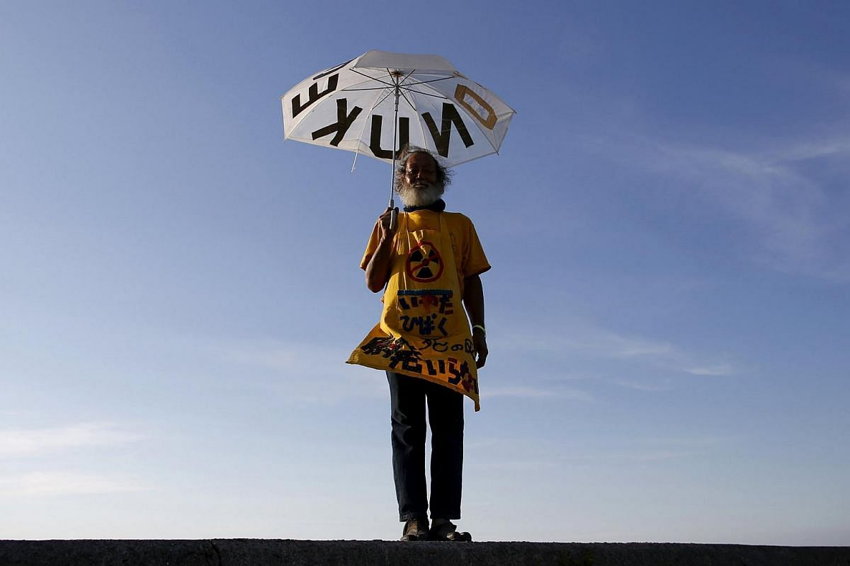66-year-old Mitsuro Sudo poses for a photograph at the protesters' campsite near Kyushu Electric Power's Sendai nuclear power station in Japan on Aug 8, 2015.