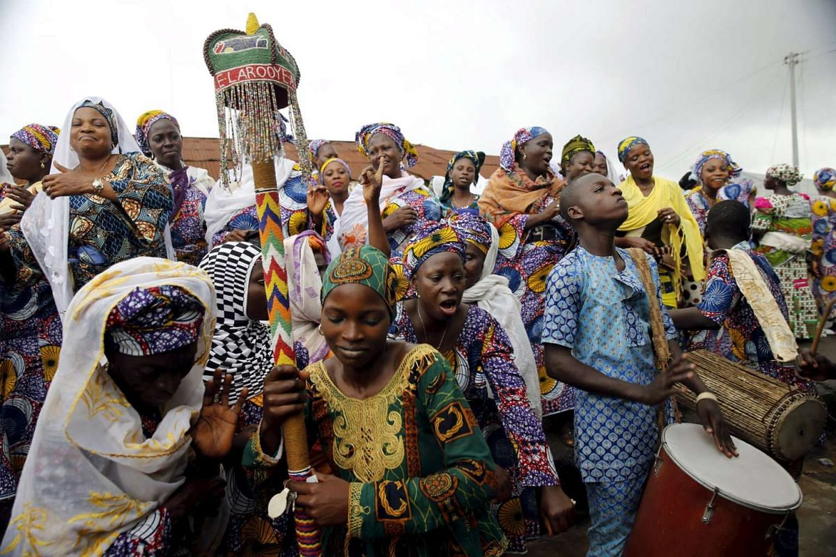 Devotees of the river goddess Osun dance down a street during the traditional town cleansing procession at the start of the annual Osun festival in Osogbo in Nigeria's southwest, August 10, 2015.