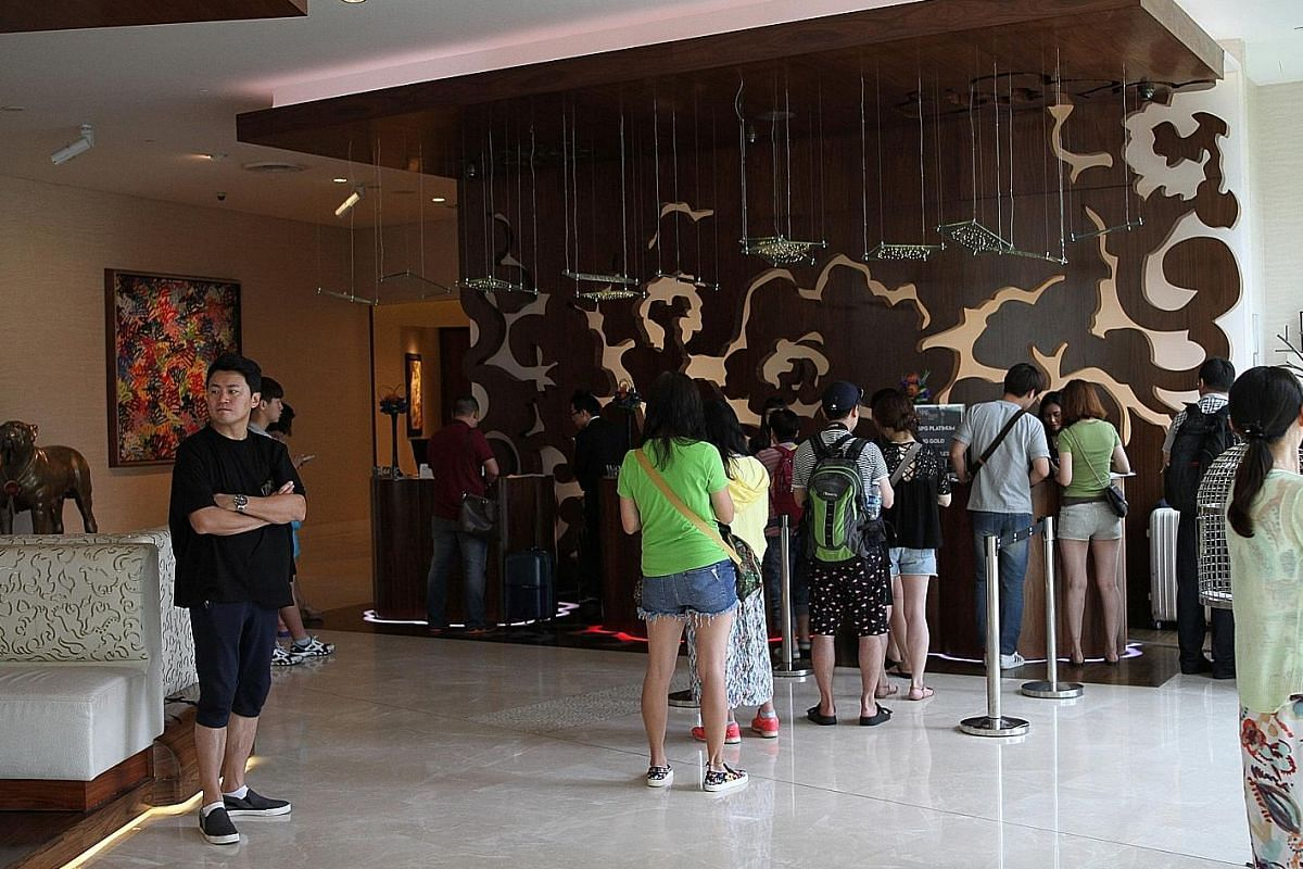 Queues like this one at the front desk of W Singapore Sentosa Cove might become a thing of the past when more guests use smart features, such as checking in and out through an app or using smartphones to unlock doors.