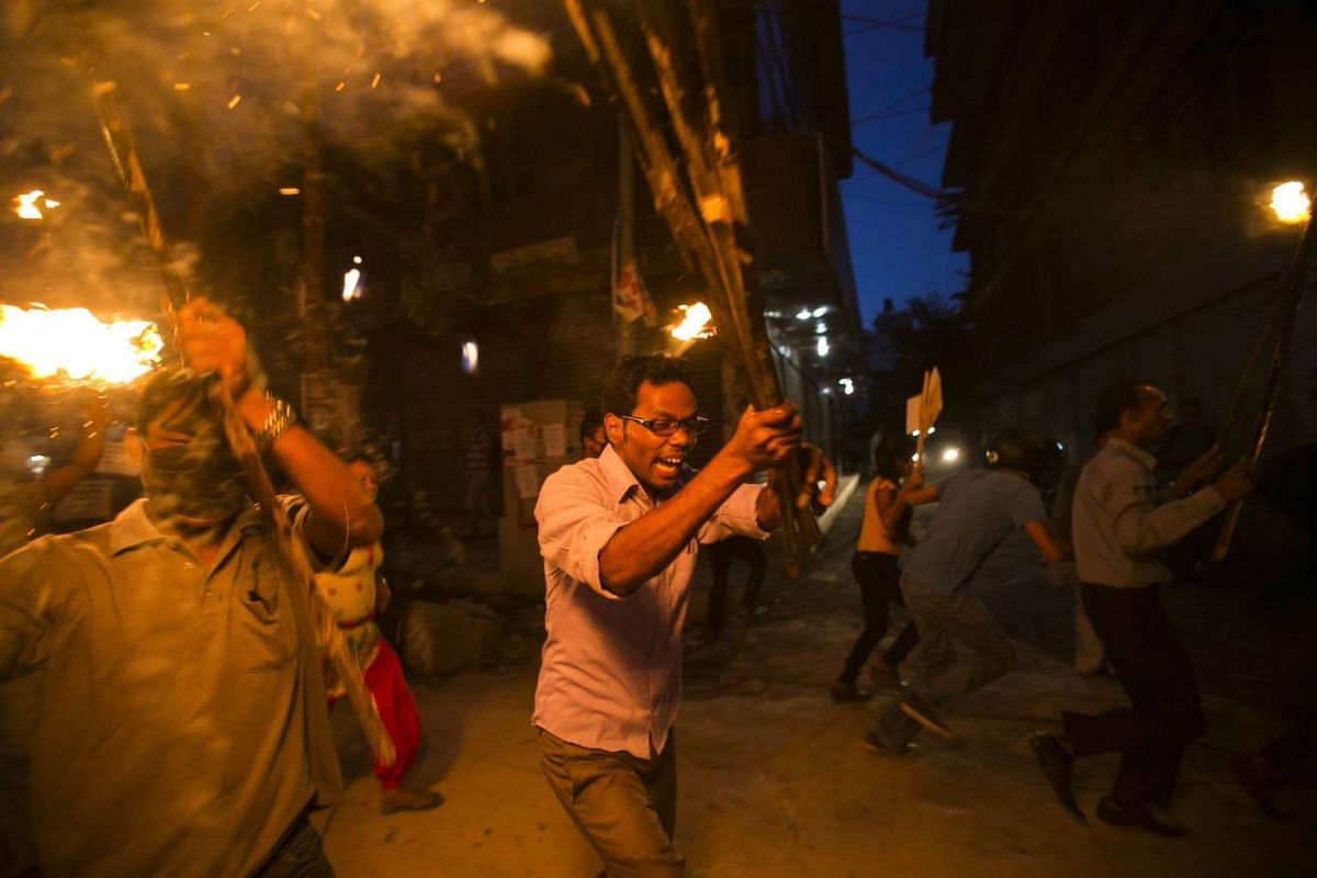 Nepalese protesters staging a torch rally in Kathmandu, Nepal, on Aug 11, 2015. Hundreds of activists from the Nepal Tharu community staged a torch protest against the final draft of the Nepalese constitution.