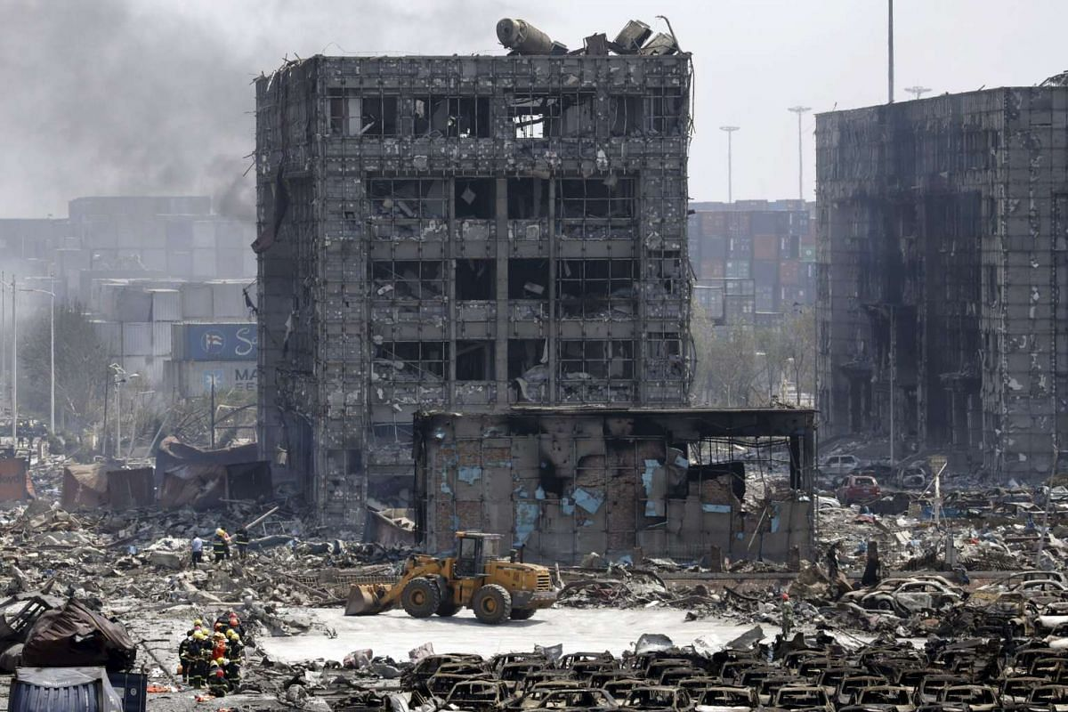 Damaged buildings and cars are seen near the site of the explosions at the Binhai new district, Tianjin city, on Aug 13, 2015.