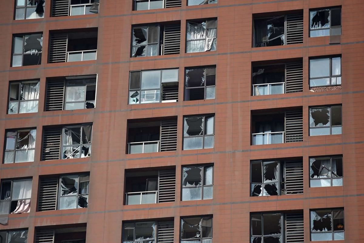 Shattered windows are seen on the façade of a residential building near the site of a series of explosions in Tianjin, northern China on Aug 13, 2015.