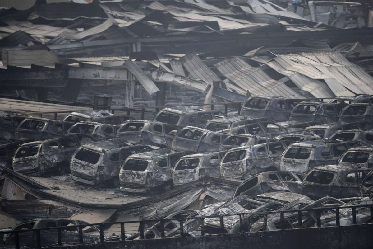 Damaged vehicles at the site of the explosions at the Binhai new district in Tianjin on Aug 13, 2015.
