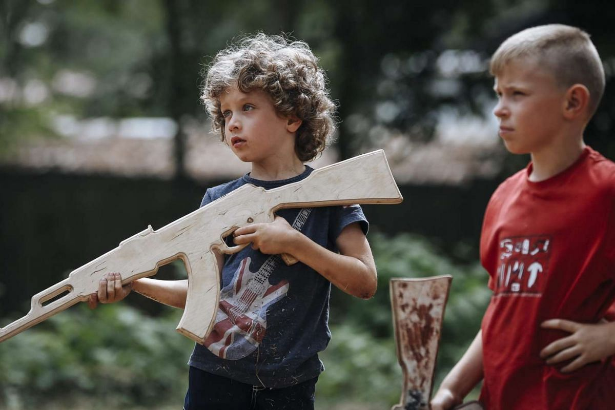 Ukrainian children holding mock weapons at a youth military summer camp on the outskirts of Kiev on Aug 12.