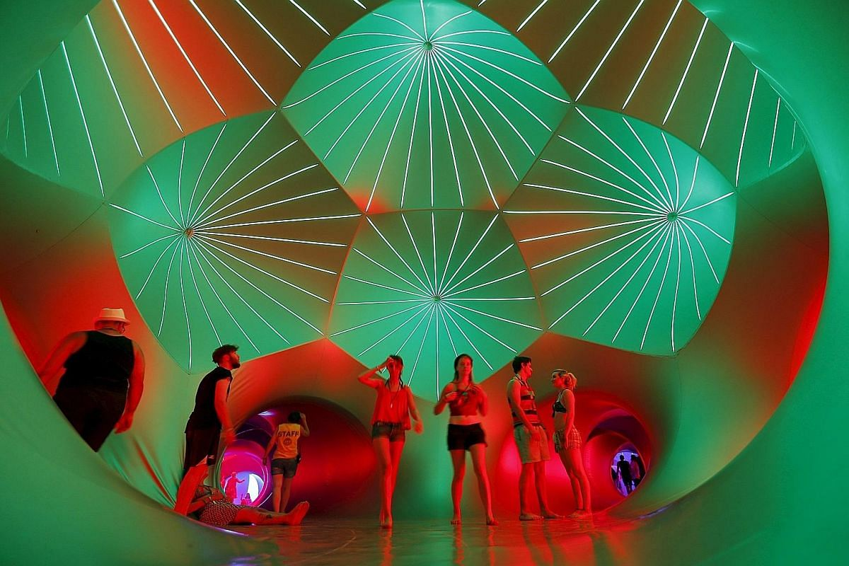"""One of the highlights of the Sziget music festival, the luminarium is a maze of winding tunnels and soaring domes. It also features """"pods"""" where visitors can rest and relax."""