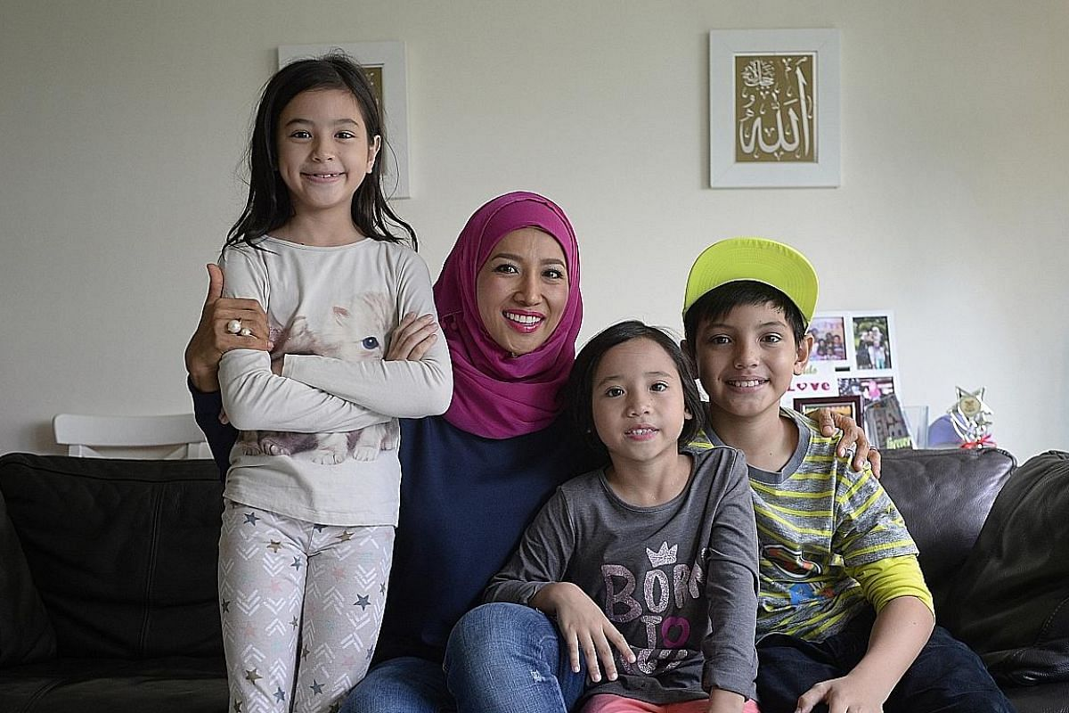 Ms Rynna Atmareh, 39, and her children (from left) Myshea, nine, Inez, seven, and Dean, 10. All three children have attended financial literacy workshops and one of them, Myshea, even won the overall award of $200 cash at the workshop that she attend