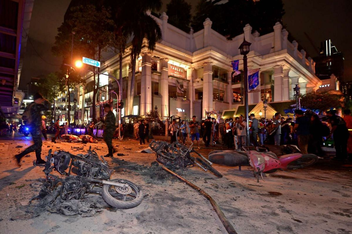 Thai soldiers cordoned off the scene after a bomb exploded outside the Erawan Shrine in central Bangkok late on Aug 17, 2015. Body parts were scattered across the street after the explosion in the downtown Chidlom district of the Thai capital.
