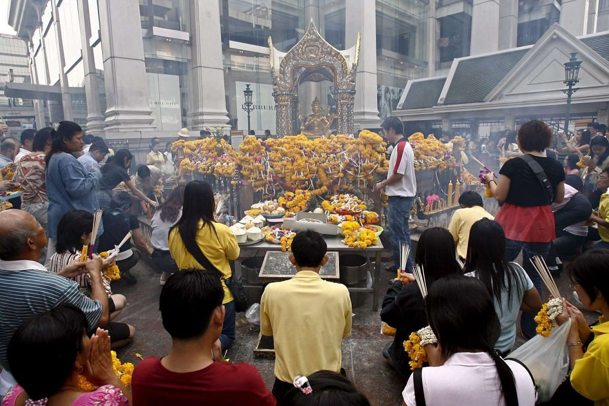 A file photo dated Jan 1, 2007, showing Thais and tourists gathering to pray for New Year blessings at Erawan Shrine near Central World shopping centre in Bangkok, Thailand.