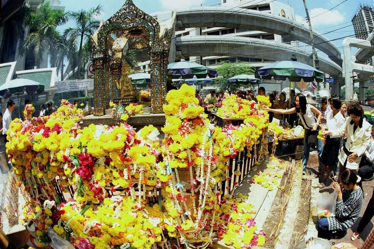 This file photo taken on Sept 9, 1999, shows tourists paying homage at the Erawan Shrine in central Bangkok.