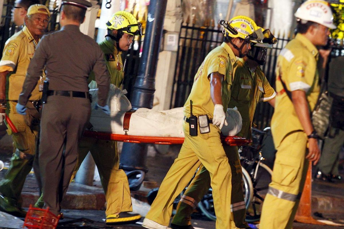 Rescue workers carry the body of a victim from the Erawan Shrine, the site of a deadly blast in central Bangkok Aug 17, 2015.