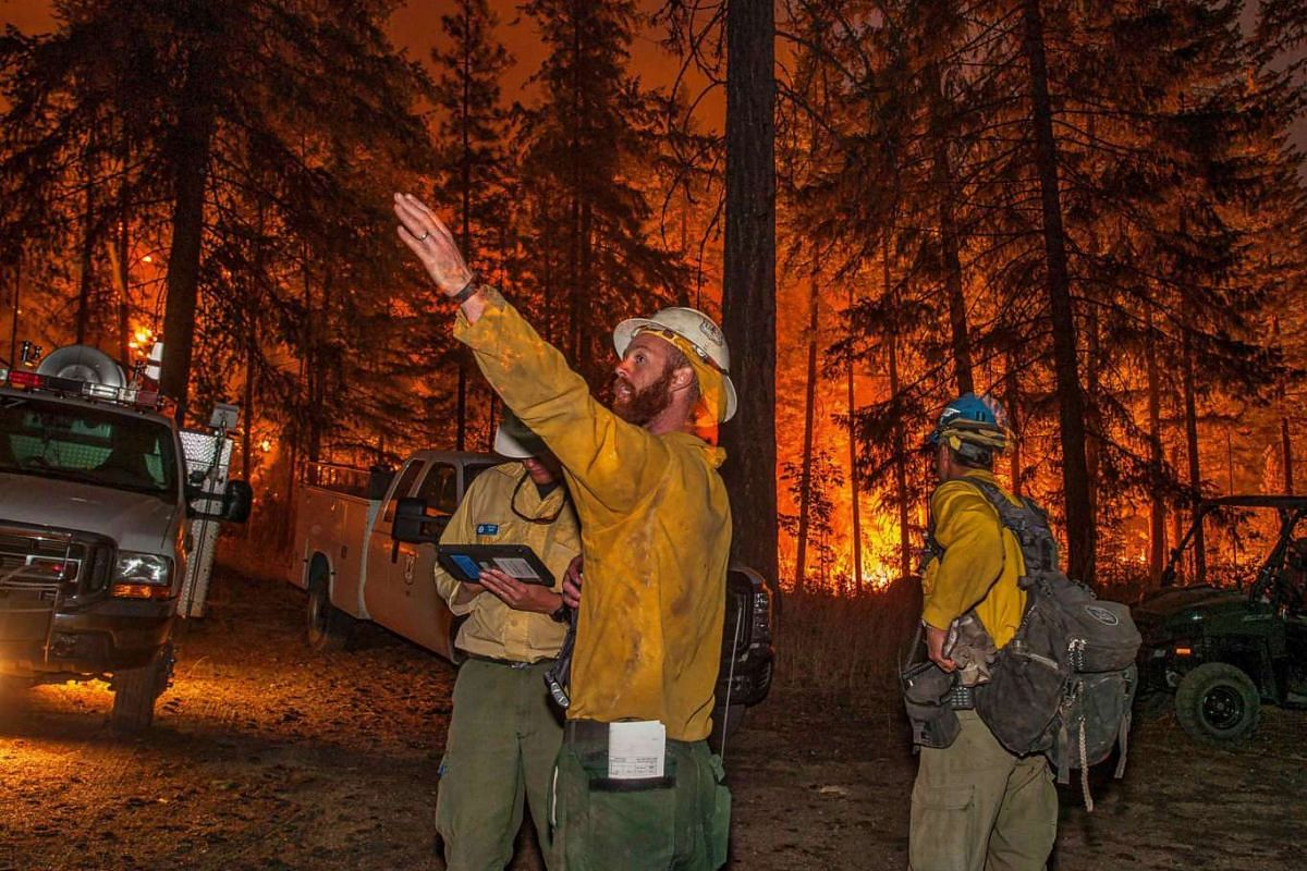 Firefighters preparing to battle the Wolverine wildfire near Chelan, Washington, in this US Forest Service picture taken on Aug 16, 2015. Wildfires have destroyed 50 homes in north-central Idaho while a fire in north-central Washington nearly doubled