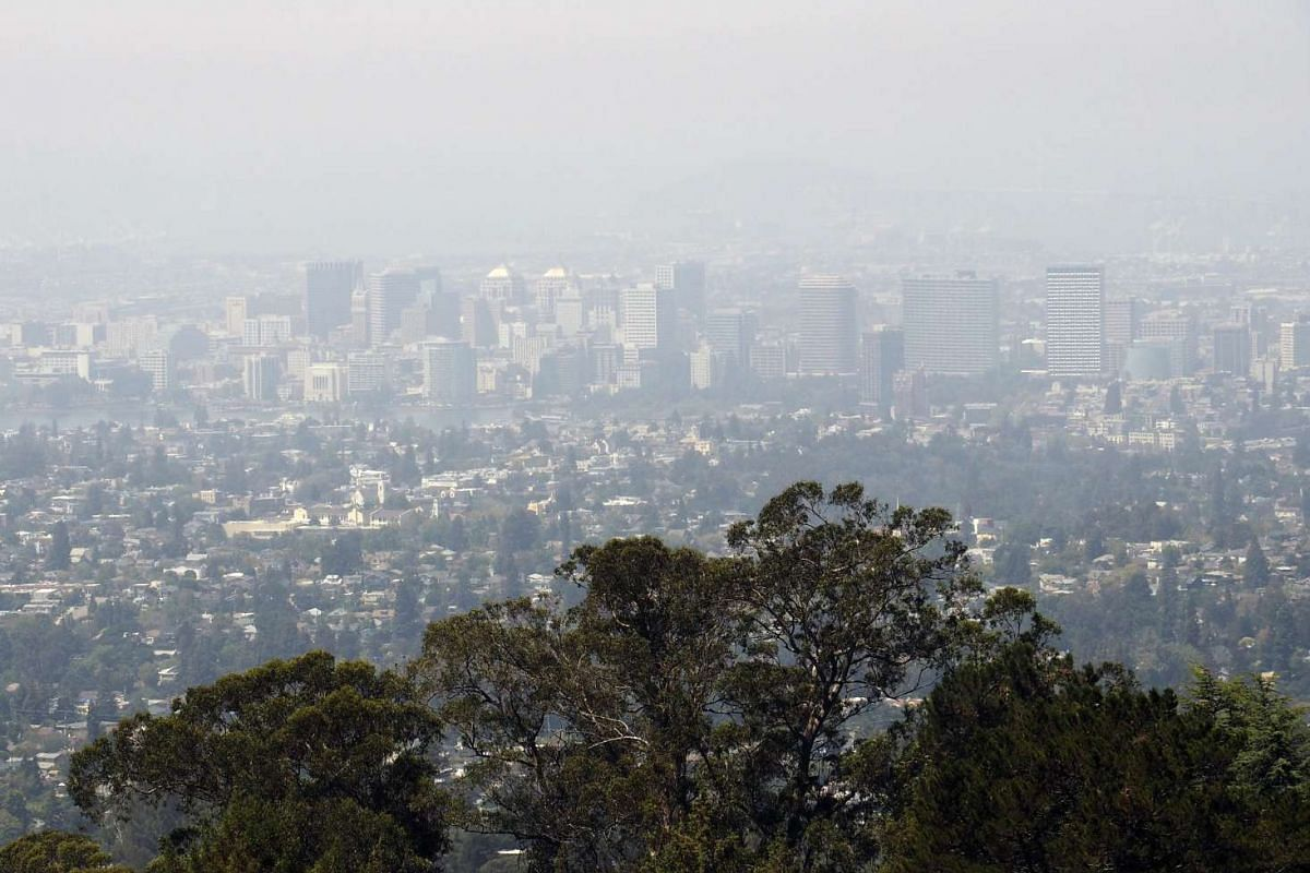 Thick haze, reportedly coming from wildfires burning in Northern California, covering downtown Oakland and the San Francisco Bay Area on Aug 17, 2015. The Bay Area Air Quality Management District (BAAQMD) extended its Spare the Air alert as it was ra