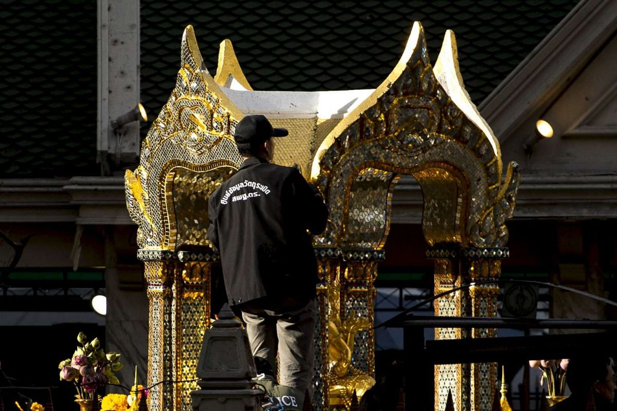 An expert examining the Erawan Shrine on Aug 18, 2015, a day after the deadly bomb blast in central Bangkok, Thailand.