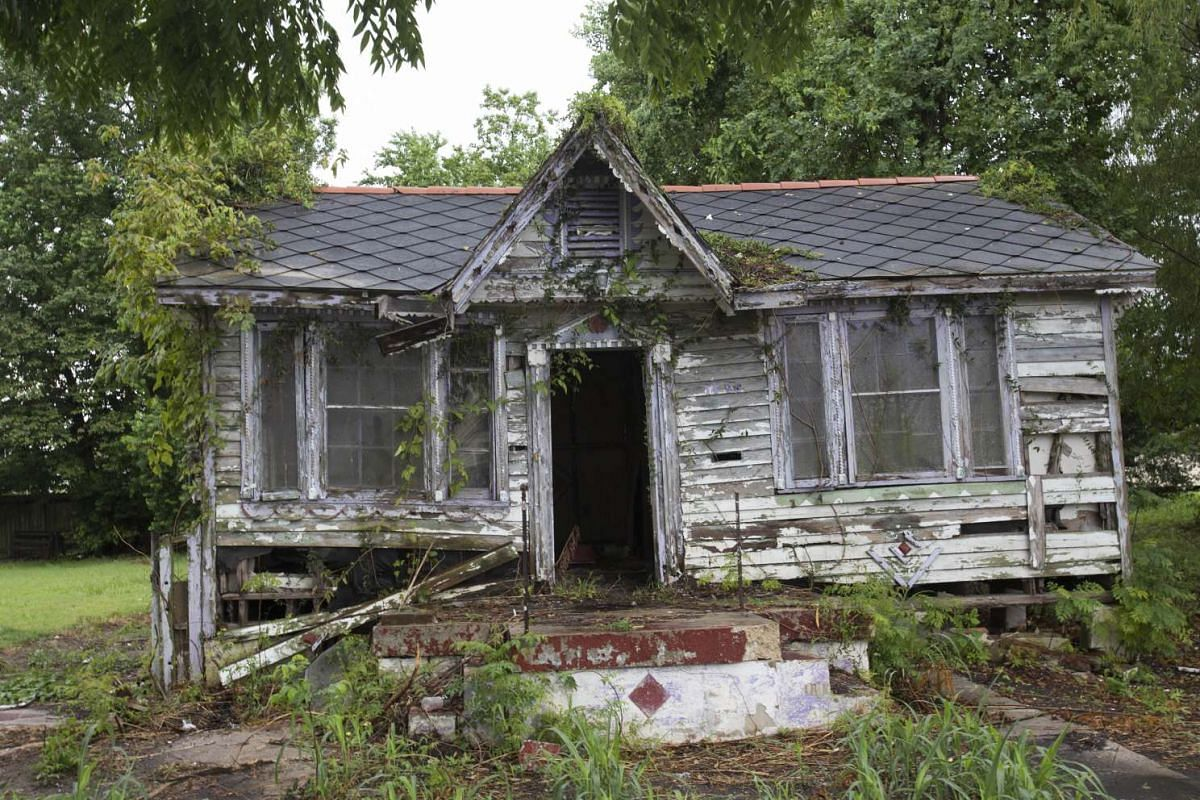 An abandoned house, damaged by Hurricane Katrina, is seen in the lower Ninth Ward of New Orleans on Aug 17, 2015.