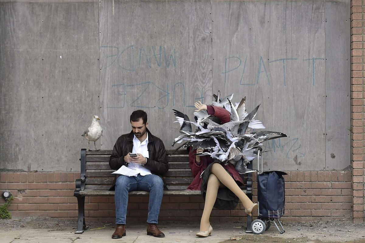Artworks, sculptures and performers at Dismaland.