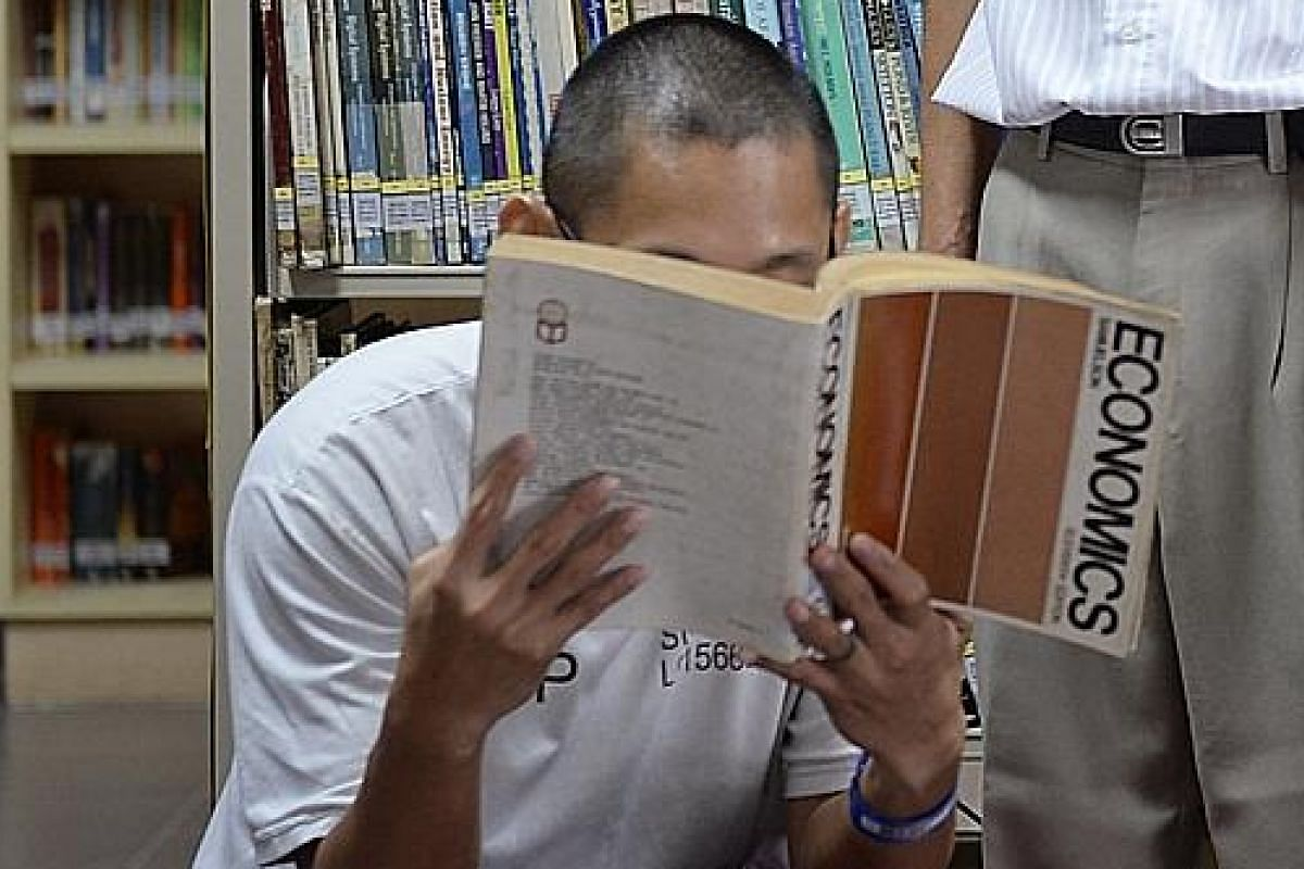 The Straits Times first spoke to Mr Swee last year, when he emerged the top A-level student in the Tanah Merah Prison School. Prison policy prohibited having his face shown in the photograph.