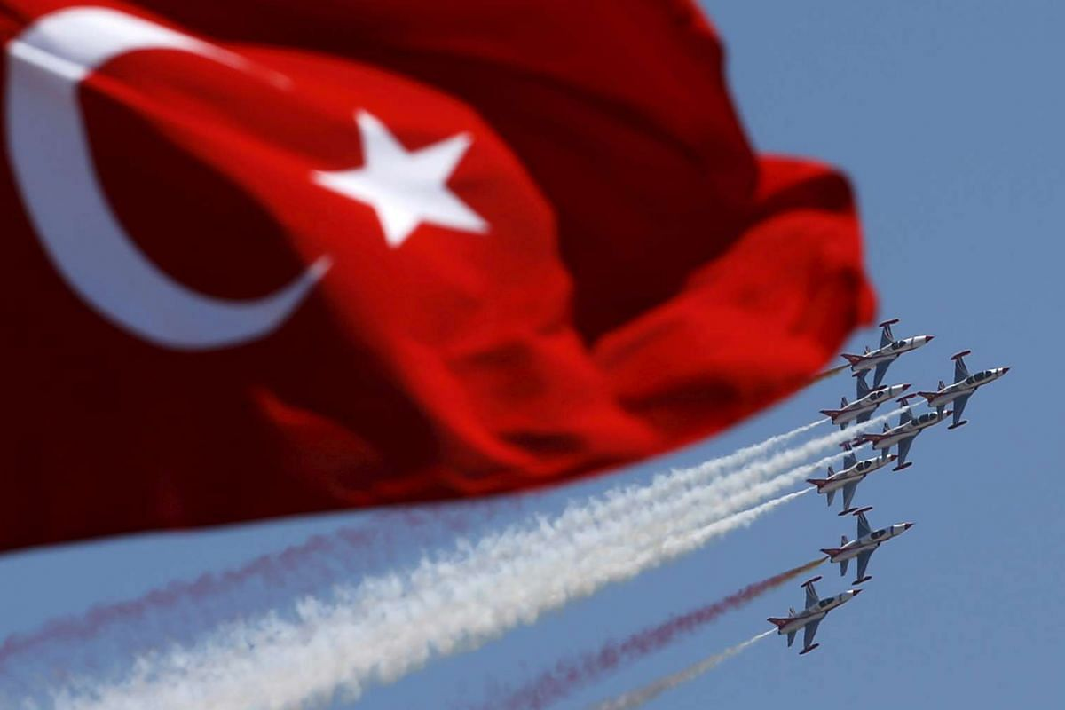 Turkish Stars, the aerobatic team of the Turkish Air Force, performing a manoeuvre during a ceremony marking the 93rd anniversary of Victory Day in Ankara, Turkey, Aug 30, 2015.