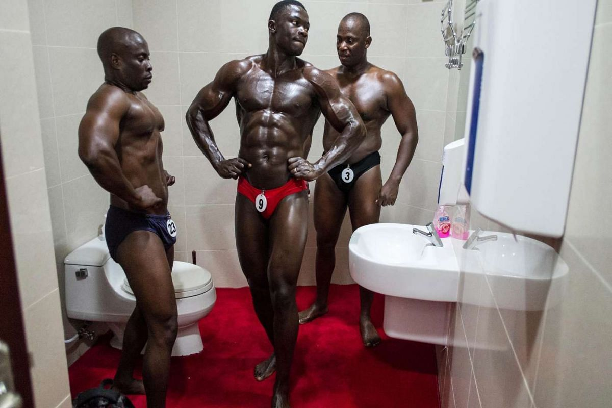Contestants preparing in the restroom before the Most Muscular Man - Tanzania competition in Tanzania's capital, Dar es Salaam, on Aug 30, 2015.