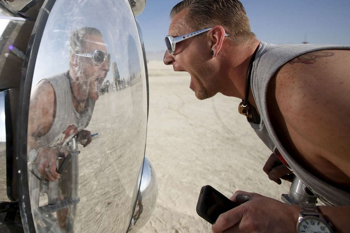 Visitor Wilf Griese interacting with an art installation called Compound Eye at the Burning Man 2015 Carnival of Mirrors arts and music festival in the Black Rock Desert of Nevada on Sept 1, 2015.