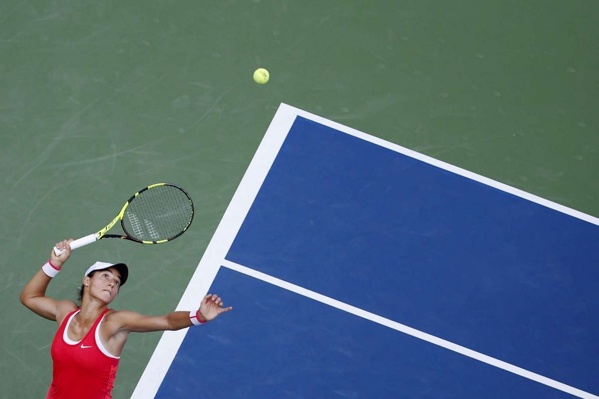 Caroline Garcia of France serves the ball to Andrea Petkovic of Germany in their first-round match at the US Open Championships tennis tournament in New York on Sept 1, 2015.