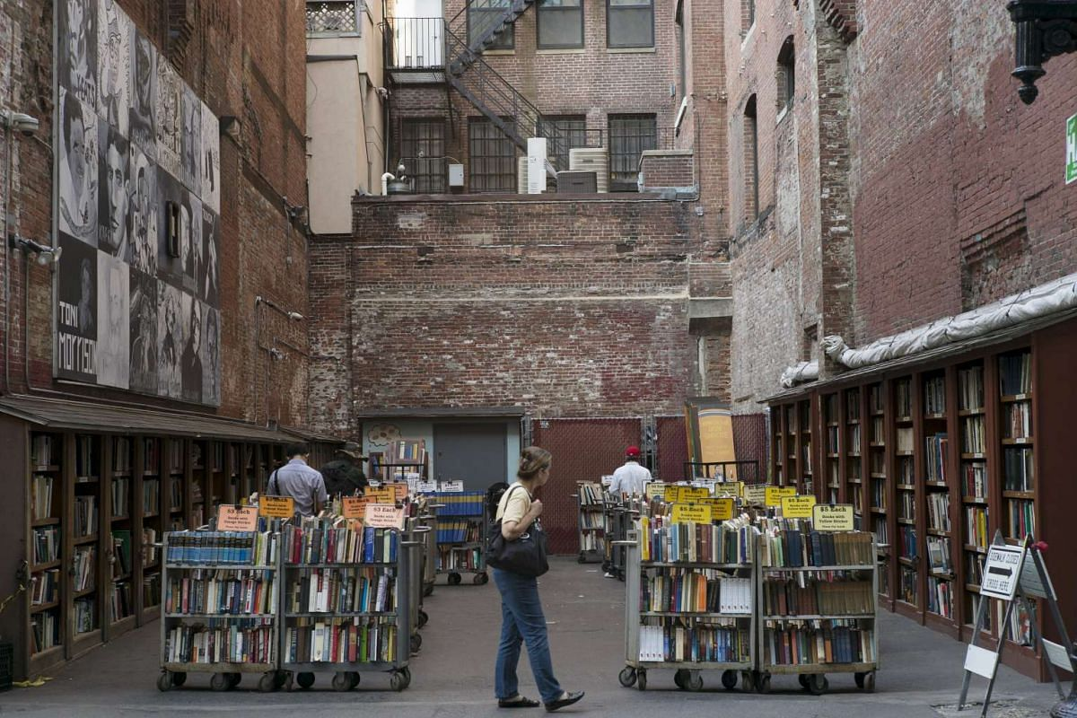 Customers browsing the used books for sale at the Brattle Book Shop in an alley in downtown Boston on Sept 1, 2015.