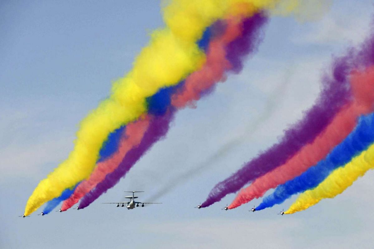 A formation of military airplanes, consisting of one KJ-2000 aircraft and eight J-10 fighter jets, fly past the central business area (CBD) of Beijing during a military parade marking the 70th anniversary of the end of World War Two, in Beijing, Chin