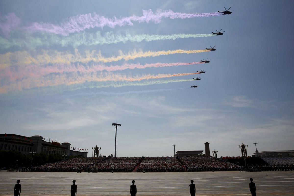 Military helicopters flying in formation over Chinese soldiers on Tiananmen Square during the military parade marking the 70th anniversary of the end of World War II, in Beijing, China, on Sept 3, 2015.