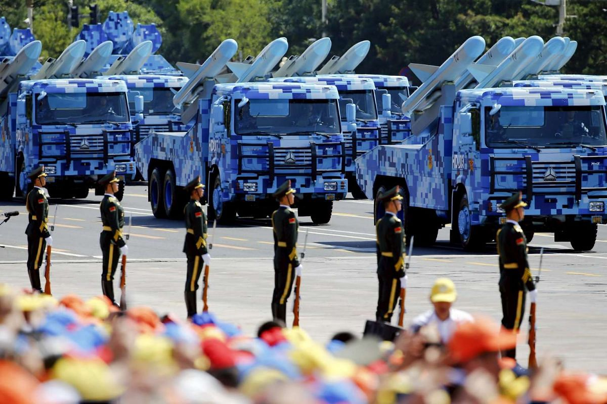 China's People's Liberation Army (PLA) navy soldiers on their armoured vehicles carrying ship-to-air missiles roll to Tiananmen Square during the military parade marking the 70th anniversary of the end of World War II, in Beijing, China, on Sept 3, 2