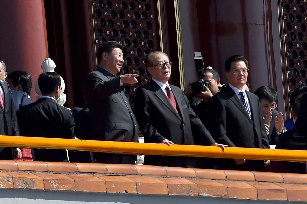 Chinese President Xi Jinping (left) talks with former president Jiang Zemin during the military parade marking the 70th anniversary of the end of World War II in Beijing, China on Sept 3, 2015. To Mr Jiang's left is former president Hu Jintao.
