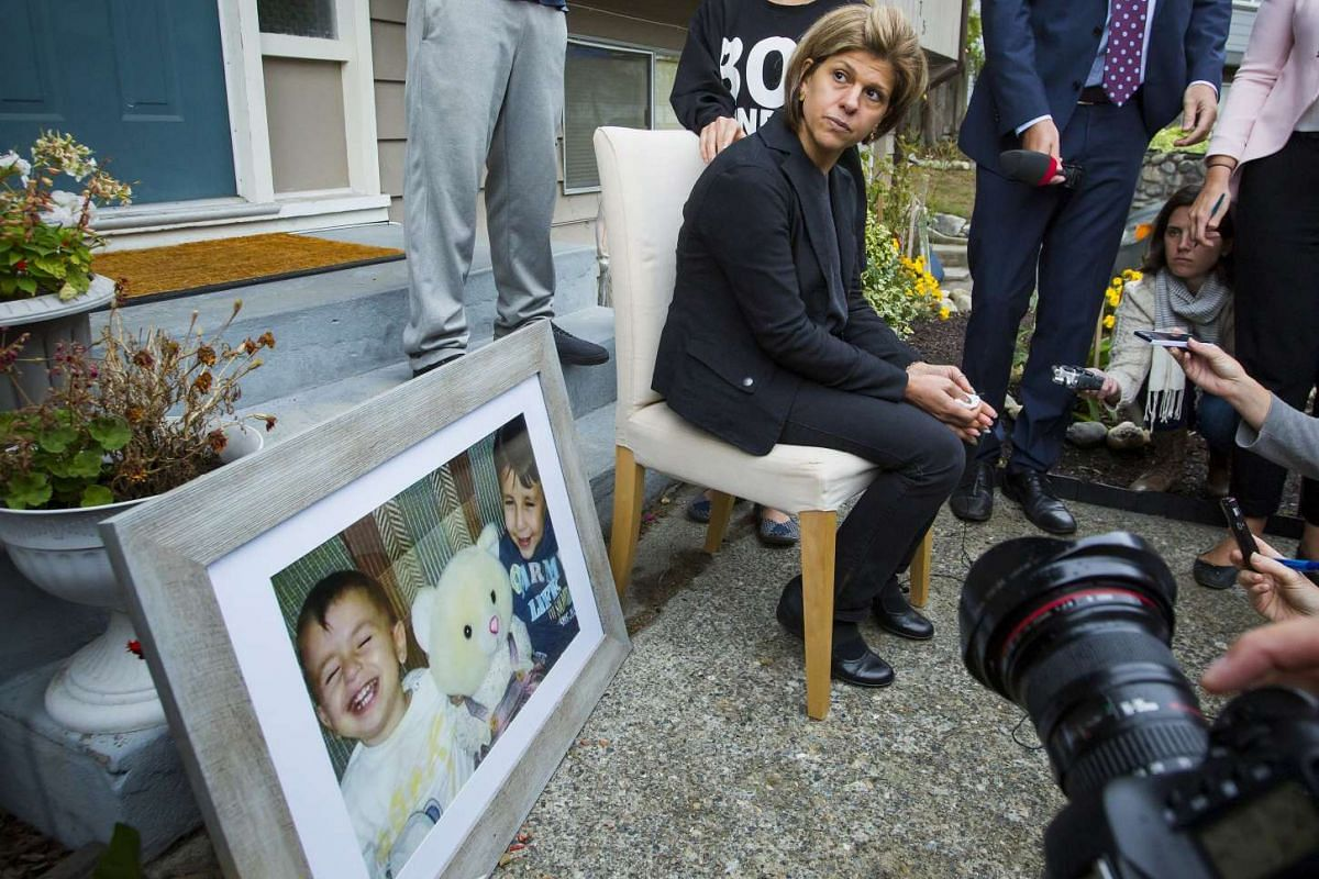 Tima Kurdi, sister of Syrian refugee Abdullah Kurdi whose sons Aylan and Galip and wife Rehan were among 12 people who drowned in Turkey trying to reach Greece, cries while speaking to the media outside her home in Coquitlam, British Columbia Septemb