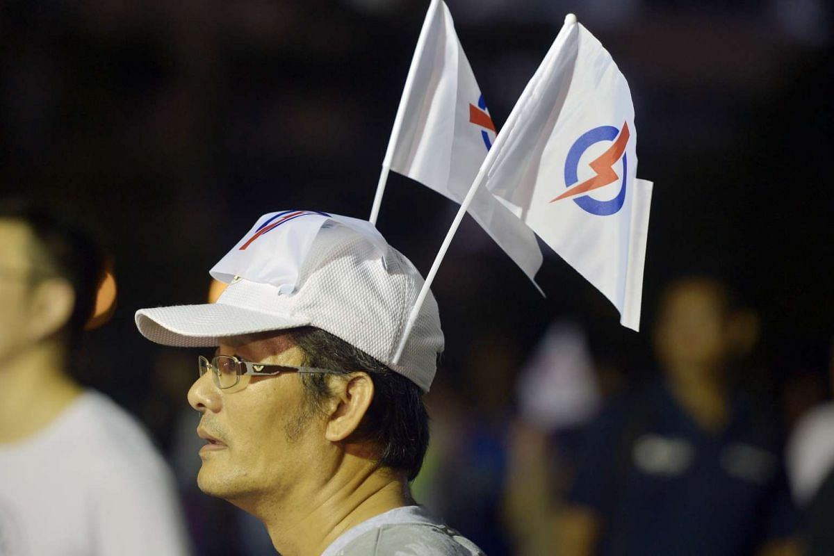 A PAP supporter at the party's rally at Petir Road.