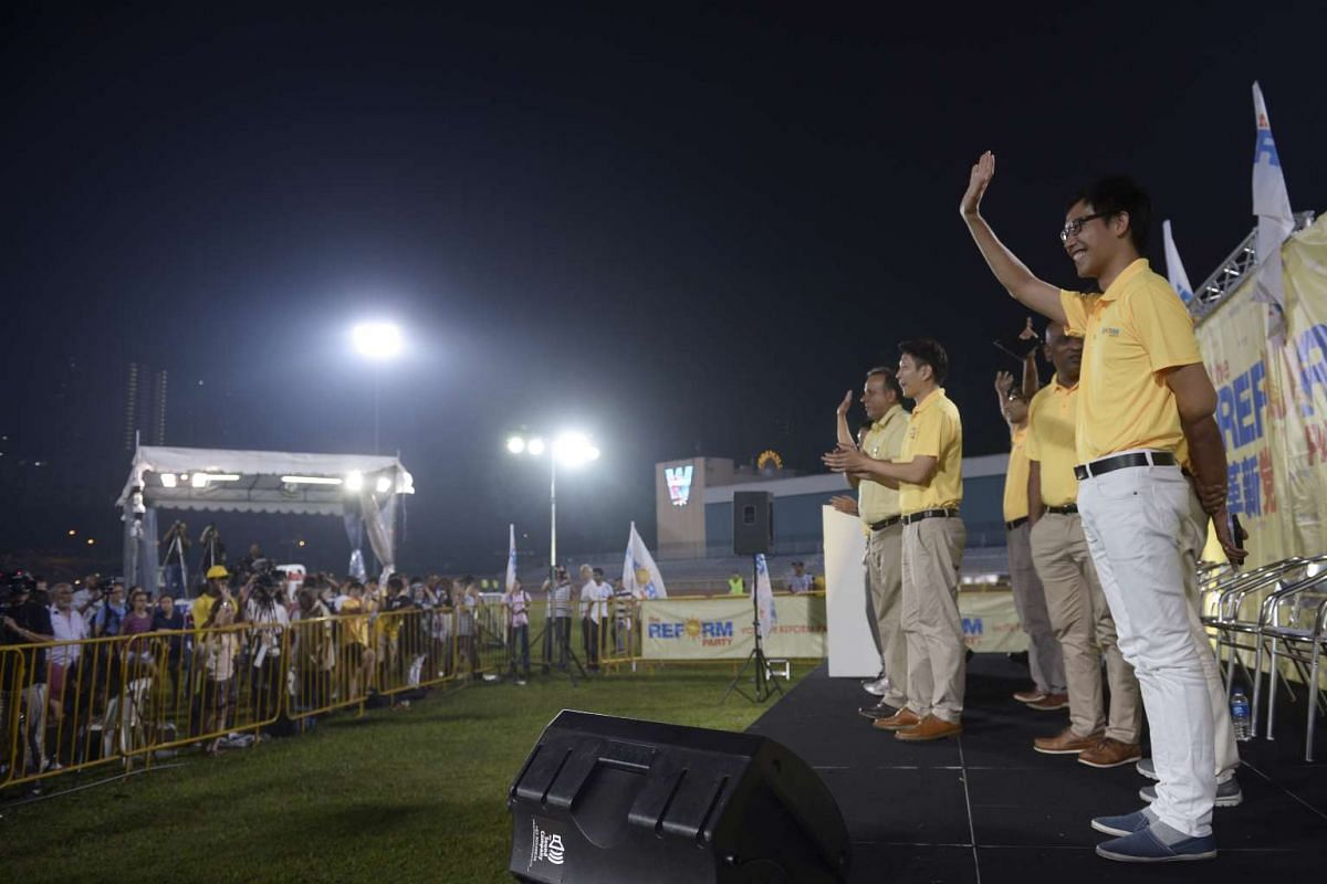 Reform Party candidates waving to their supporters at the end of their rally at Clementi Stadium on Sept 5, 2015.