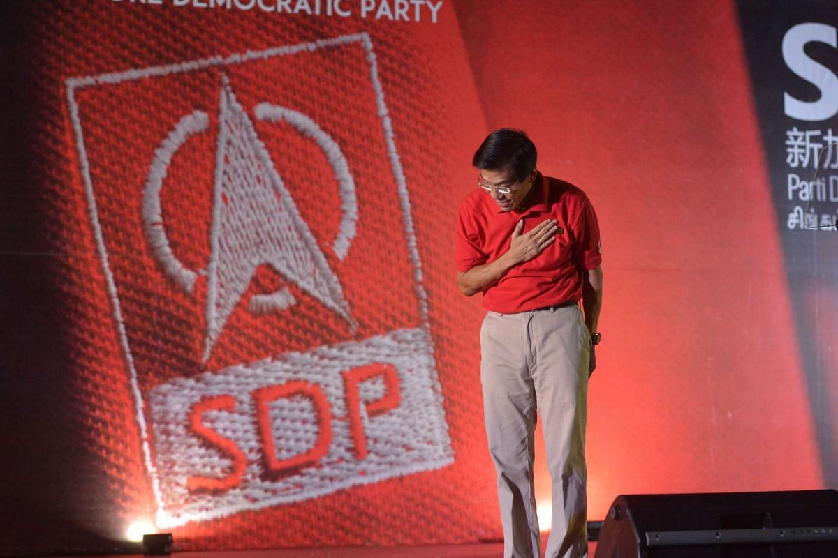 Dr. Chee Soon Juan bows to the crowd during the Singapore Democratic Party rally for Holland-Bukit Timah GRC, at an open field along Commonwealth Avenue beside the Commonwealth MRT station on Sept 6, 2015.